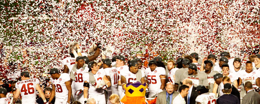 Football team being sprinkled by confetti after National Championship win